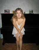 Blonde_russian_teen_posing_naked_on_her_bed