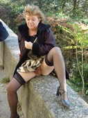 A_mature_wife_posing_outdoors