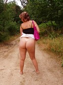 Chubby_chick_showing_her_great_round_ass